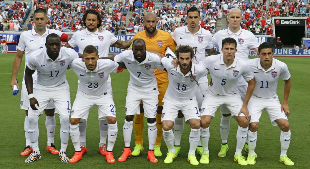 """While the rest of the world is held captive by its collective interest, Americans sigh a definitive, """"meh."""" In this photo, the United States soccer team poses for a photo before an international friendly soccer match against Nigeria in Jacksonville, Fla., Saturday, June 7, 2014. (John Raoux/AP)"""