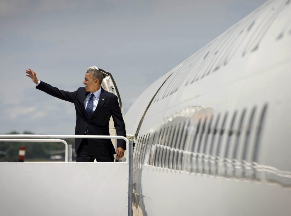 President Barack Obama waves before boarding Air Force One on Wednesday, June 11 before traveling to Worcester, Mass. to deliver a commencement address. (Pablo Martinez Monsivais/AP)