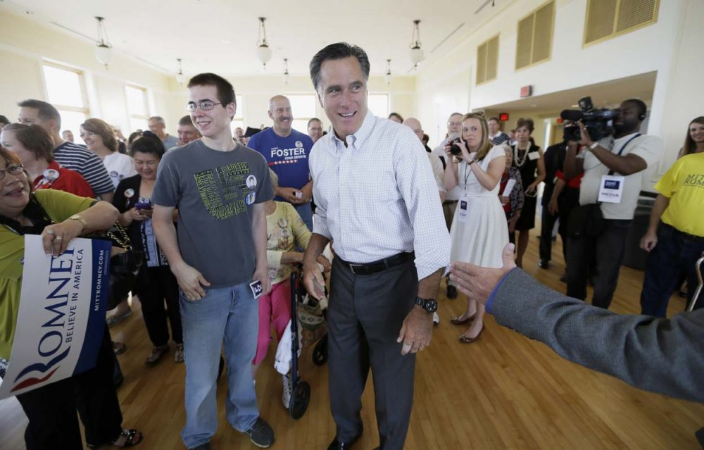 Mitt Romney greets supporters before speaking at a rally for Iowa Republican Senate candidate Joni Ernst in Cedar Rapids, Iowa last month. Romney is trying to re-emerge as a force in Republican politics.  (Charlie Neibergall/AP)