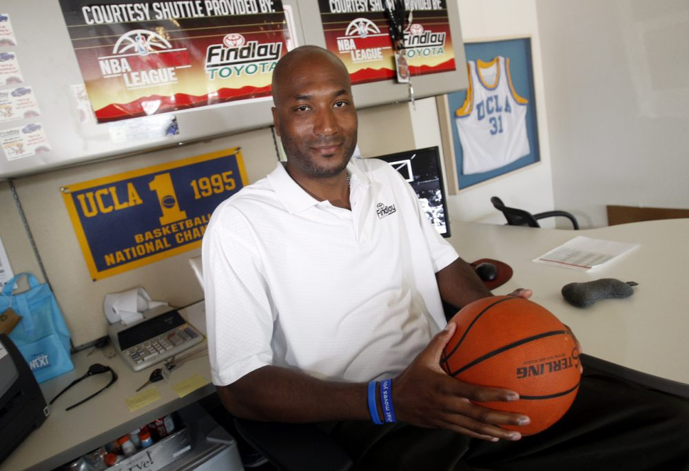 Former UCLA basketball player Ed O'Bannon Jr. sits in his office in Henderson, Nevada on Sept. 18, 2010. He spearheaded a lawsuit arguing that college athletes should be paid for use of their likenesses. (Isaac Brekken/AP)