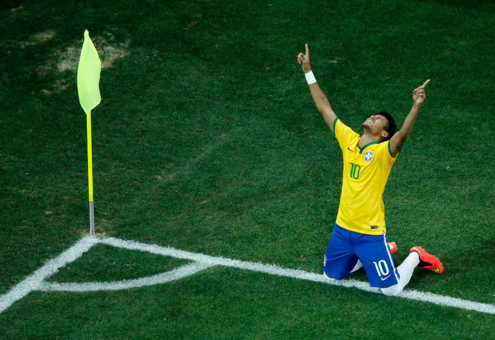 Brazilian phenom Neymar celebrates his second goal of the opening match at the World Cup. Brazil defeated Croatia 3-1. (Fabrizio Bensch - Pool/Getty Images)