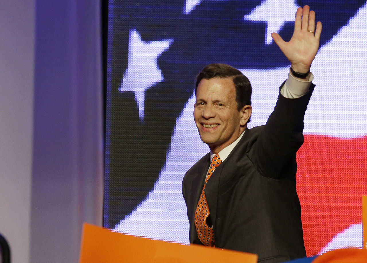 Massachusetts Treasurer Steve Grossman acknowledges the cheers of supporters as he takes the stage to address delegates at the state Democratic Convention in June. (Stephan Savoia/AP)