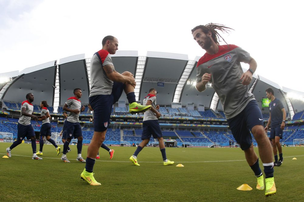 United States players warm up during an official training session on Sunday. (Julio Cortez/AP)
