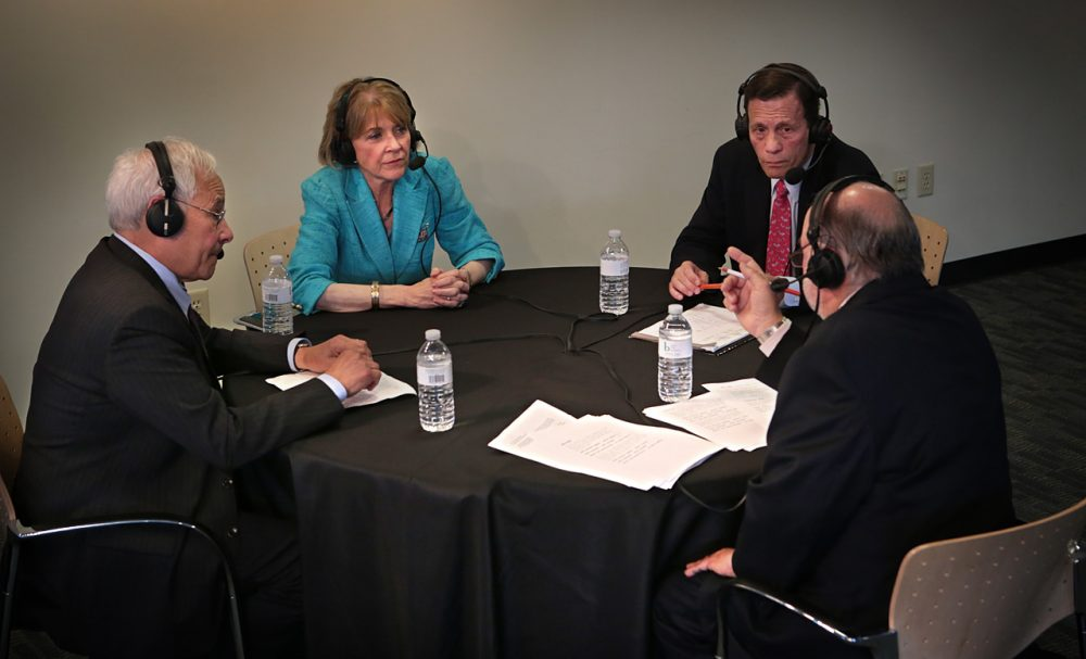 From left, Democratic gubernatorial candidates Donald Berwick, Martha Coakley and Steve Grossman debate at WBUR Wednesday morning. WBUR host Bob Oakes moderates. (Jesse Costa/WBUR)