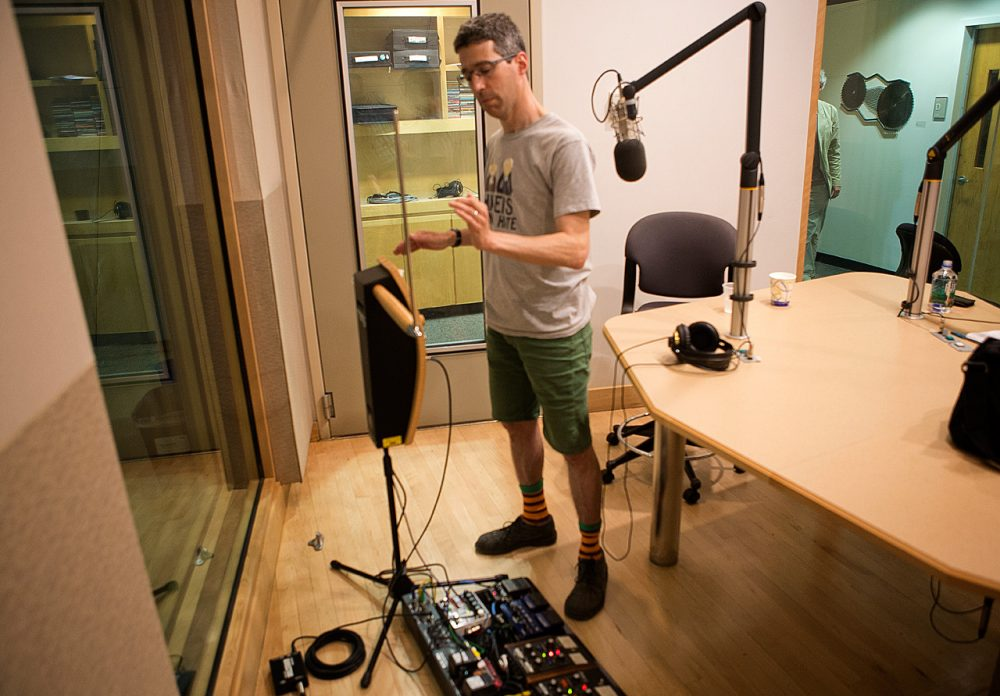 Jon Bernhardt playing the theremin in the WBUR studios. (Jesse Costa/WBUR)