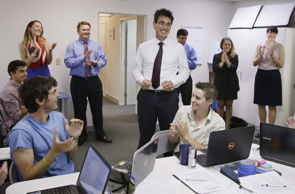 Independent candidate for Massachusetts governor Evan Falchuk informs workers at his campaign headquarters that he has become the first gubernatorial candidate to officially qualify for the November ballot. (Stephan Savoia/AP)