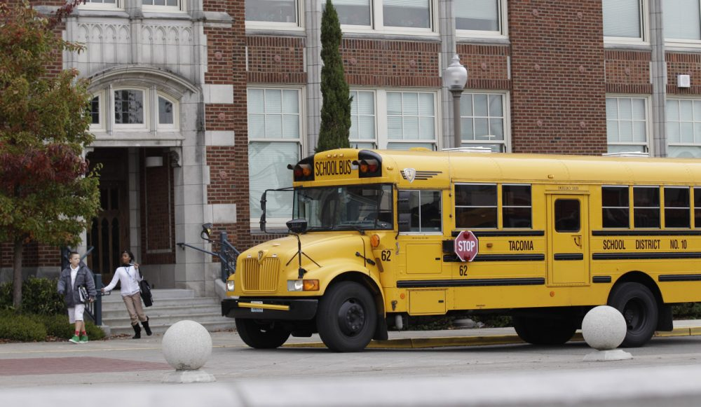 A school bus waits to pick up students at Jason Lee Middle School in Tacoma, Wash. (Ted S. Warren/AP)