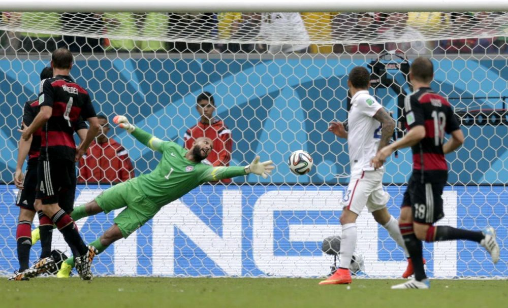 U.S. goalkeeper Tim Howard can't stop a shot by Germany's Thomas Mueller during the group G World Cup soccer match between the United States and Germany at the Arena Pernambuco in Recife, Brazil Thursday. (Julio Cortez/AP)