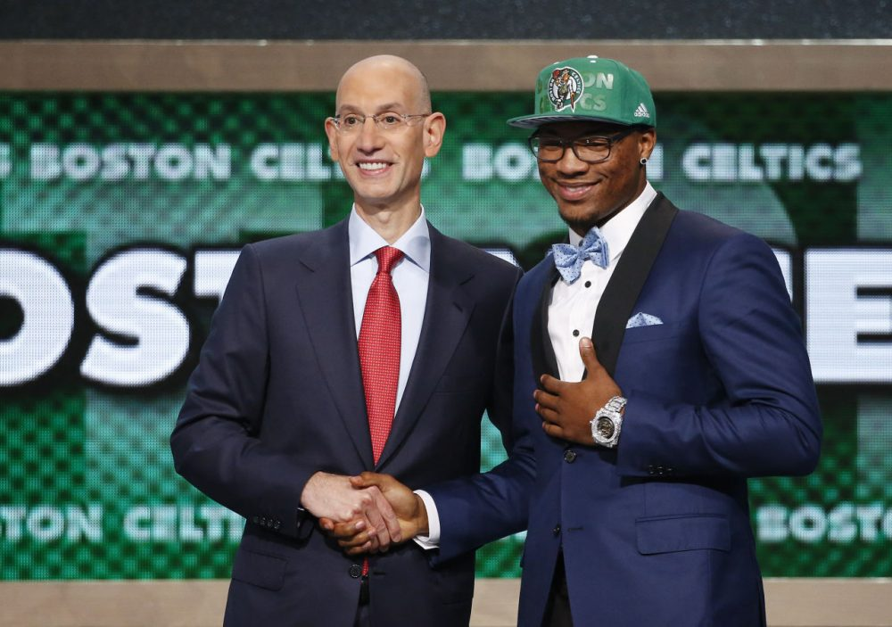 Oklahoma State's Marcus Smart, right, poses for a photo with NBA commissioner Adam Silver after being selected sixth overall by the Boston Celtics during the 2014 NBA draft, Thursday, June 26, 2014, in New York. (Jason DeCrow/AP)