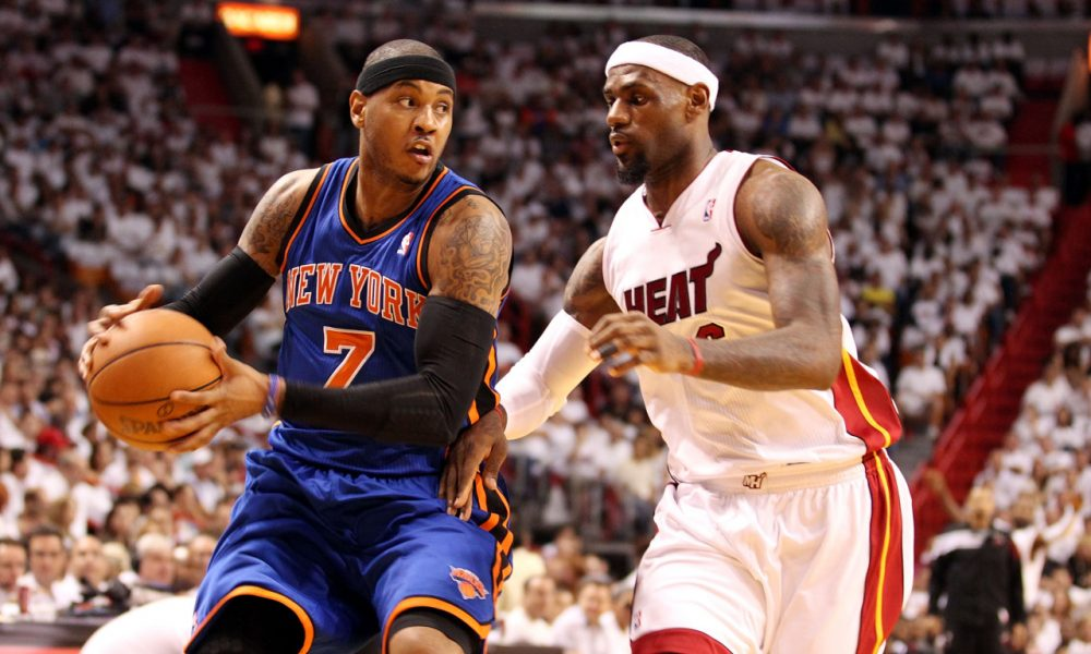 Carmelo Anthony (left) and LeBron James (right) could both be on the move this offseason. (Marc Serota/Getty Images)