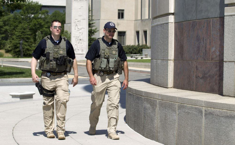 U.S. Marshalls move outside the federal U.S. District Court in Saturday after security was heightened in anticipation of a possible court appearance by captured Libyan militant Ahmed Abu Khattala later in the day.  (Jose Luis Magana/AP)