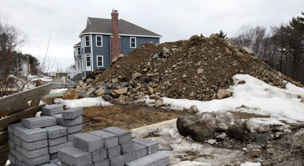 Curtatone and Leroux: The state's 40-year-old zoning act favors sprawl over sustainable development. Pictured: Housing construction in North Andover, Mass., March 21, 2014. (Elise Amendola, File/AP)