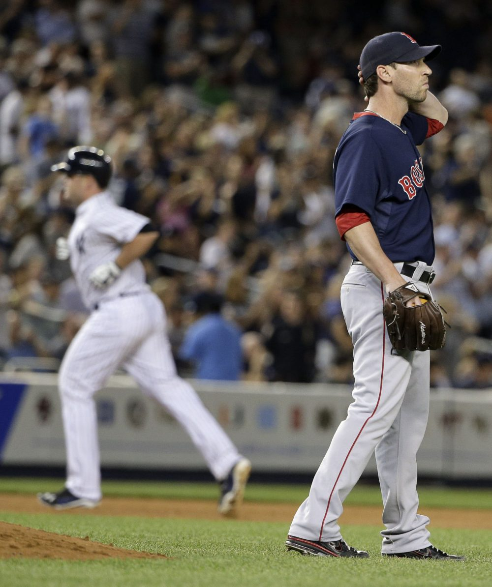 Boston Red Sox pitcher Craig Breslow, right, reacts after giving up a two-run home run to New York Yankees' Brian McCann, left. (AP Photo/Julie Jacobson)
