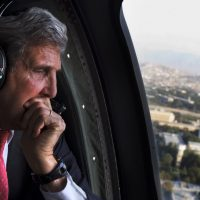 Eileen McNamara: U.S. Sec. of State John Kerry seems to have forgotten how he used to feel about dissenters being called traitors. In this Oct. 11, 2013, file photo, Kerry looks out the window en route to the ISAF headquarters after a visit to Kabul, Afghanistan. (Jacquelyn Martin/AP)