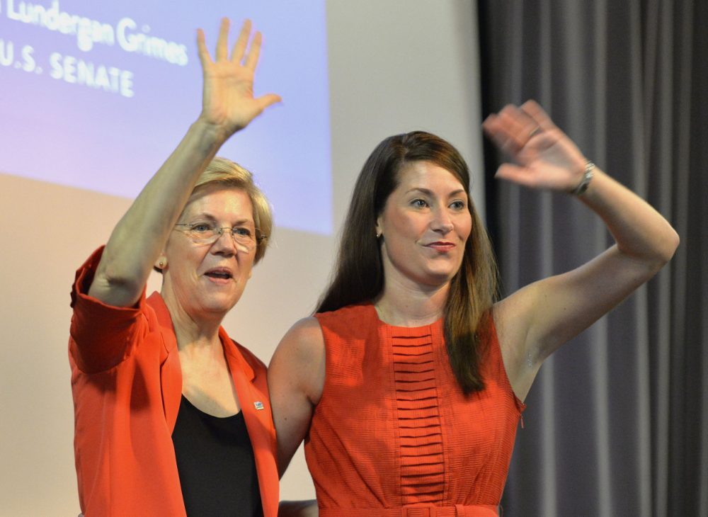 Democratic U.S. Sen. Elizabeth Warren, left, of Massachusetts and Kentucky democratic Senatorial candidate Alison Lundergan Grimes wave to supporters at at rally on Sunday, June 29, 2014 at the University of Louisville in Louisville, Ky. Warren has been canvassing the country following a failed vote in the U.S. Senate that would have allowed some people to refinance their student loan debt to take advantage of lower interest rates. (AP)