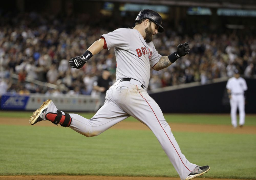 Boston Red Sox's Mike Napoli rounds first base after hitting a solo home run over against the New York Yankees in the ninth inning Saturday. The Red Sox won 2-1. (Julie Jacobson/AP)