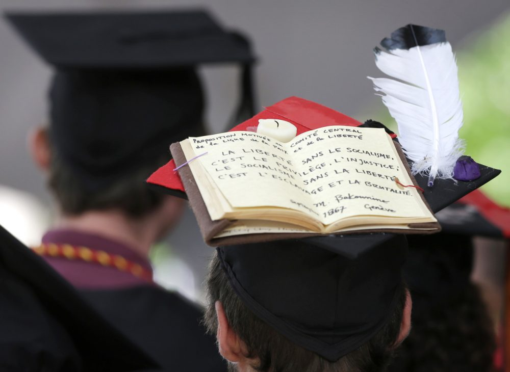 A graduating Harvard University student wears a mortar board that features a book and a feather during Harvard commencement ceremonies, Thursday, May 29, 2014, in Cambridge, Mass. (AP)