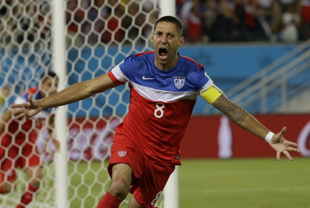 United States' Clint Dempsey celebrates after scoring the opening goal during the group G World Cup soccer match between Ghana and the United States at the Arena das Dunas in Natal, Brazil, Monday, June 16, 2014. The United States won the match 2-1. (AP)