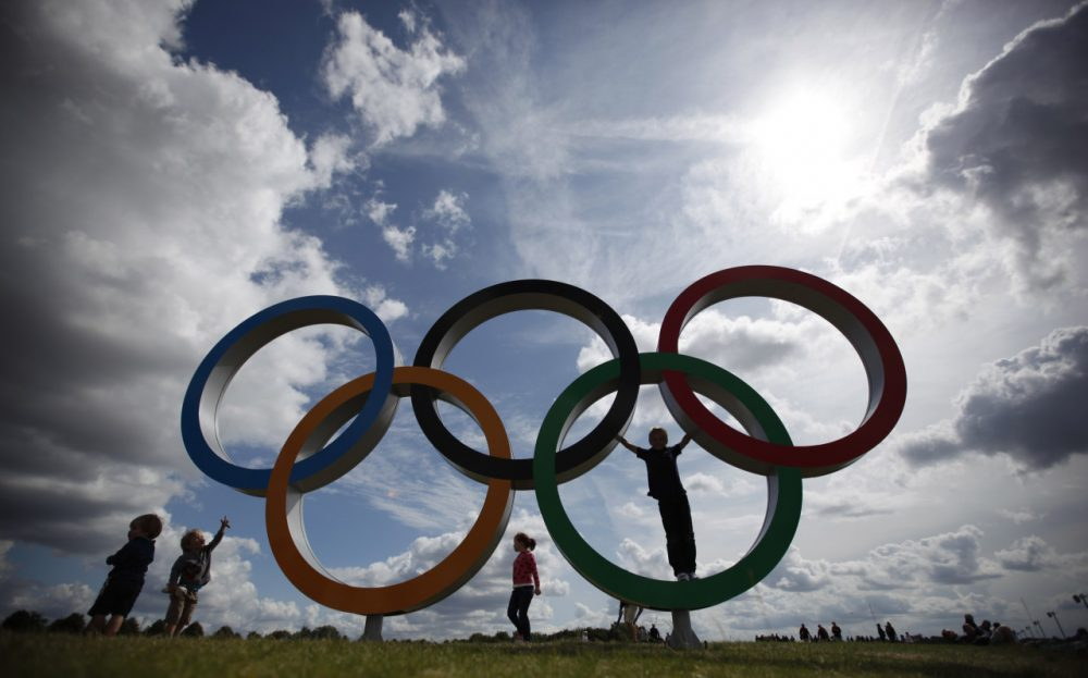 Children play on the Olympic rings in Eton Dorney, England, at the 2012 Summer Olympics. (Natacha Pisarenko/AP)