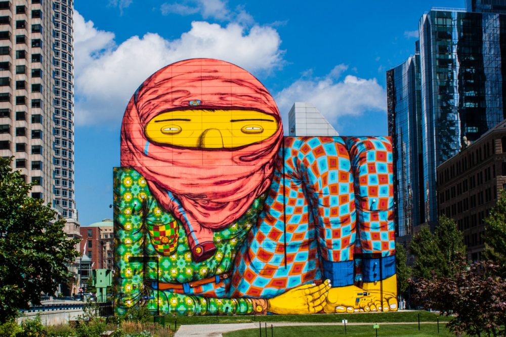 Os Gêmeos, two Brazilian twins who are famous for being at the forefront of Brazilian street art, have their first US solo show at the ICA in Boston. As part of the exhibit, they converted an air intake structure into this whimsical and colorful character on the Greenway in Boston, MA (Tim Sackton/Flickr)