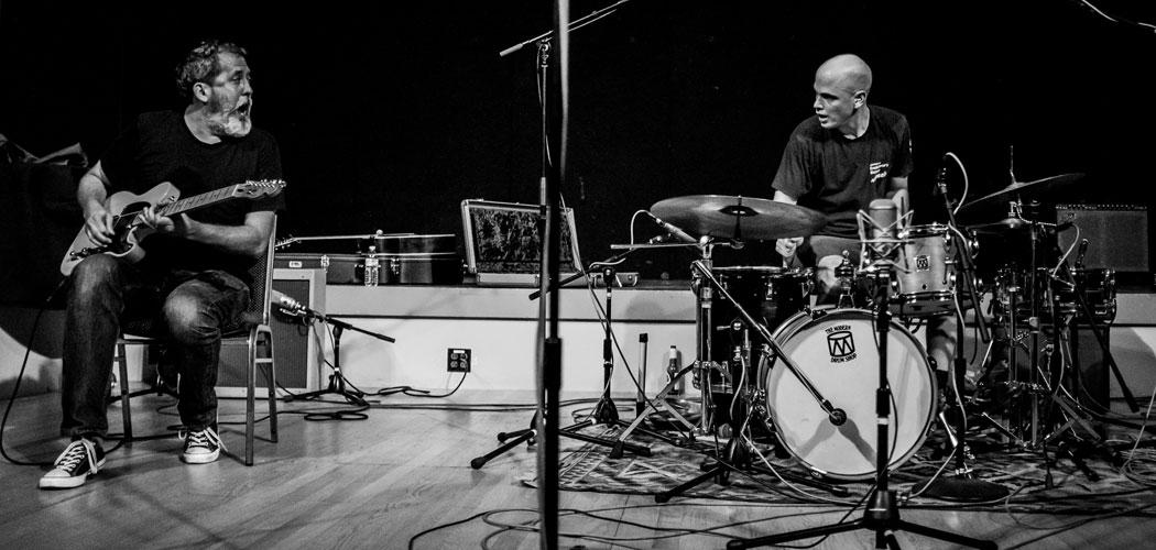 The phenomenally amazing duo of guitar mugger/melter Bill Orcutt and drummer archangel/ phantom Chris Corsano. (Peter Gannushkin)