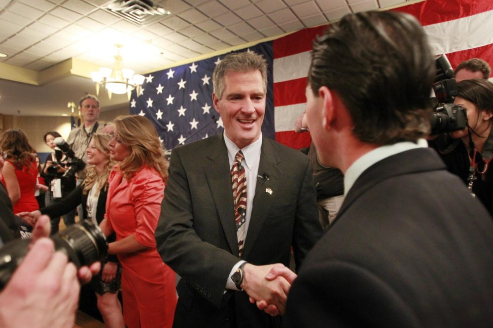 Former Massachusetts U.S. Senator Scott Brown is greeted by supporters after announcing his plans to run for U.S. Senator in New Hampshire. (Jim Cole/AP)