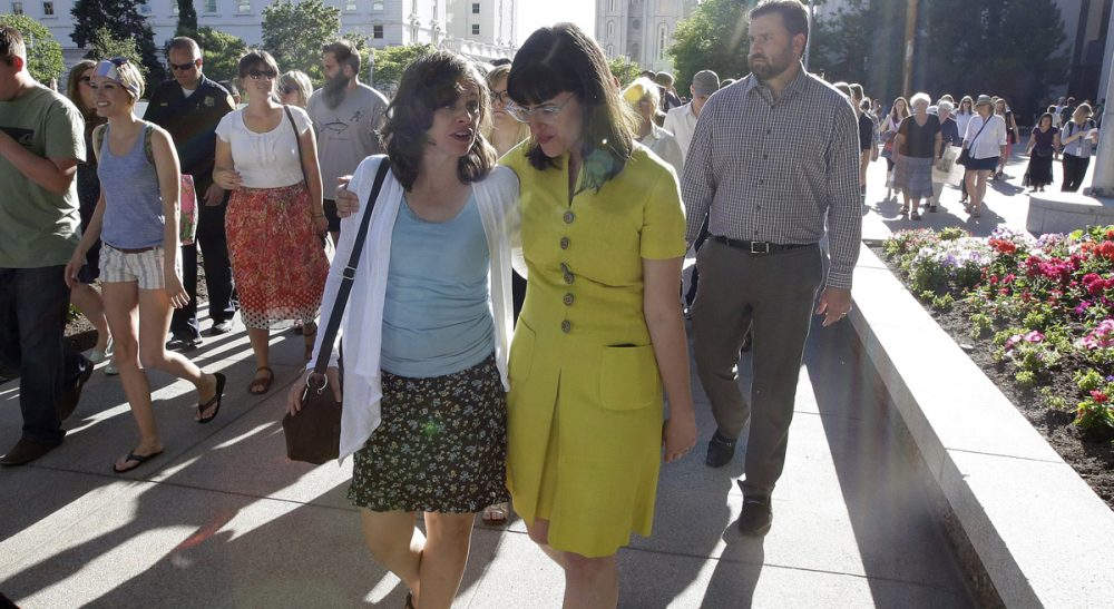 "R. B. Scott: ""The church is at an important crossroad in its 184-year history."" Pictured: Kate Kelly, right, walks with a supporter after addressing her supporters at the Church Office Building of the Church of Jesus Christ of Latter-day Saints during a vigil Sunday, June 22, 2014, in Salt Lake City. Kelly was excommunicated from The Church of Jesus Christ of Latter-day Saints in June. (Rick Bowmer/AP)"