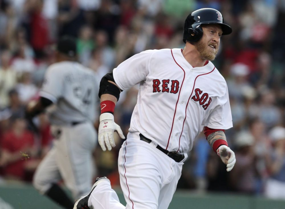 Boston Red Sox pinch hitter Mike Carp rounds first on his walk-off RBI single, breaking a 3-3 tie, against the Chicago White Sox at Fenway Park in Boston Thursday. The Red Sox defeated the White Sox 4-3 in 10 innings. (Charles Krupa/AP)