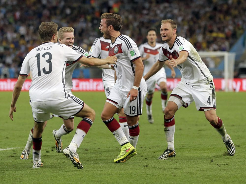 Germany's Mario Goetze (19) celebrates with teammates after scoring his side's first goal in extra time against Argentina's goalkeeper Sergio Romero during the World Cup final soccer match between Germany and Argentina at the Maracana Stadium in Rio de Janeiro, Brazil, Sunday, July 13, 2014. (Felipe Dana/AP)