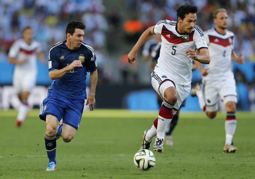 Argentina's Lionel Messi, left, and Germany's Mats Hummels go downfield during the World Cup final soccer match between Germany and Argentina at the Maracana Stadium in Rio de Janeiro, Brazil, Sunday, July 13, 2014. (Frank Augstein/AP)