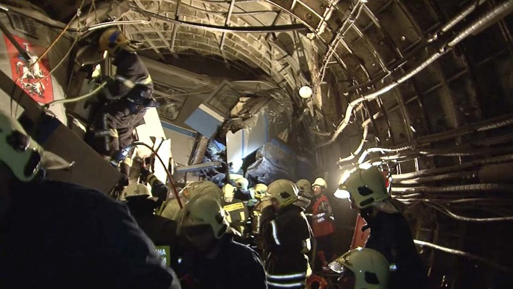 In this frame grab from video provided by the Russian Ministry for Emergency Situations, rescue teams work inside the tunnel in Moscow where subway train derailed Tuesday during rush hour, killing at least 20 people and sending 150 others to the hospital, many with serious injuries, Russian officials said. (Russian Emergency Situation Ministry/AP)