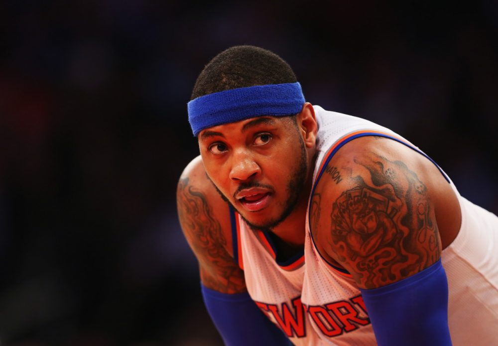 After weighing offers from around the league, Carmelo Anthony agreed to a  five-year, $124 million contract with the Knicks. (Al Bello/Getty Images)