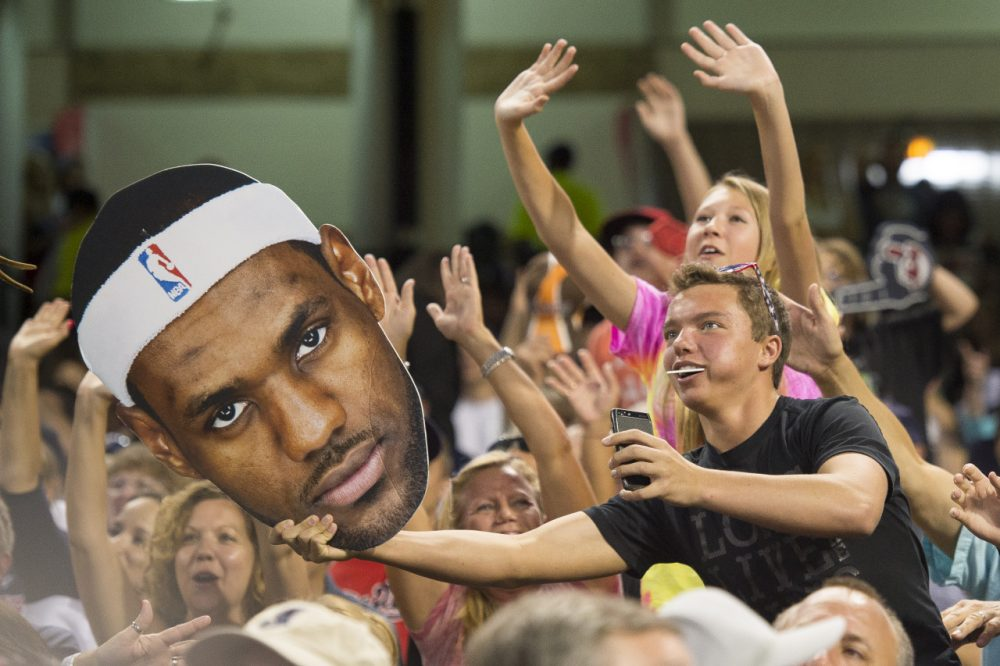 Cleveland sports fans are celebrating the return of LeBron, but will King James really add $500 million to the local economy? (Jason Miller/Getty Images)