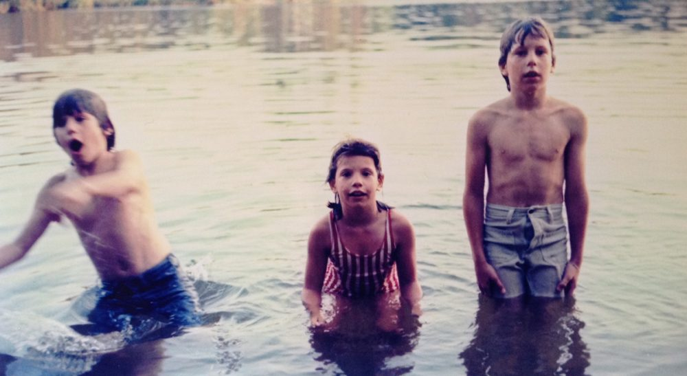 What navel gazing -- literally -- taught one boy about the value of being different. Pictured: The author (right) desperately trying to hide his outie at Wheelwright Pond in Lee, NH, c. 1977, with his siblings. (Sarah Gilsdorf/Courtesy)