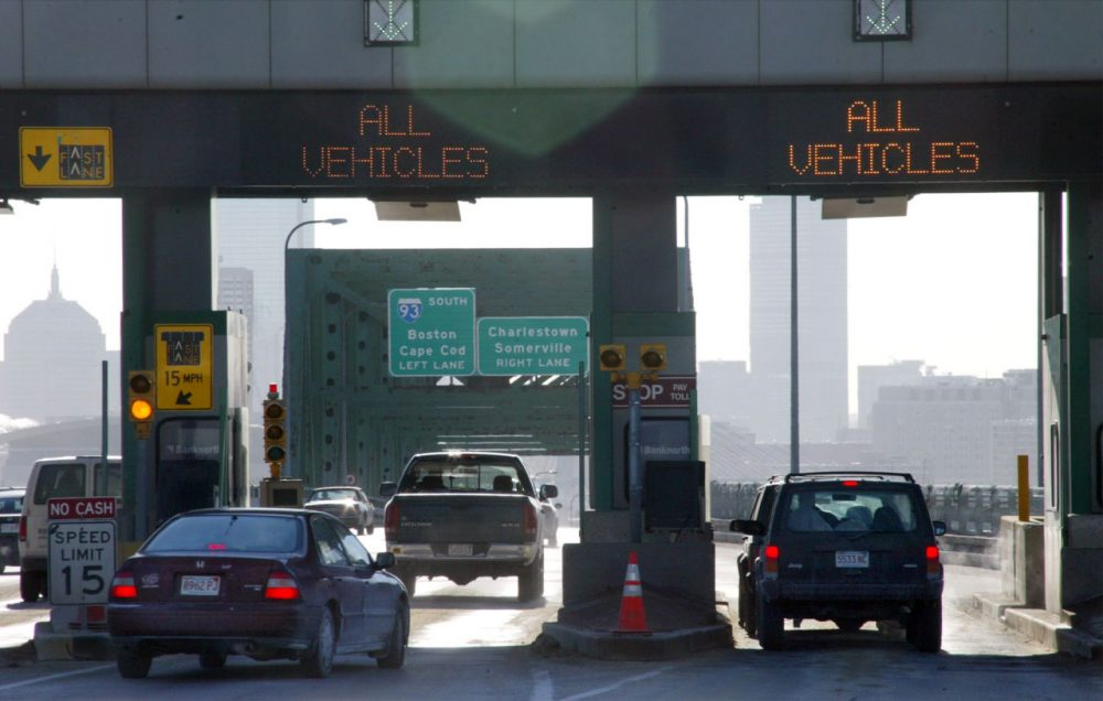 Motorists pass through toll booths on the Tobin Bridge in Boston on Jan. 15, 2004. (Robert Spencer/AP)