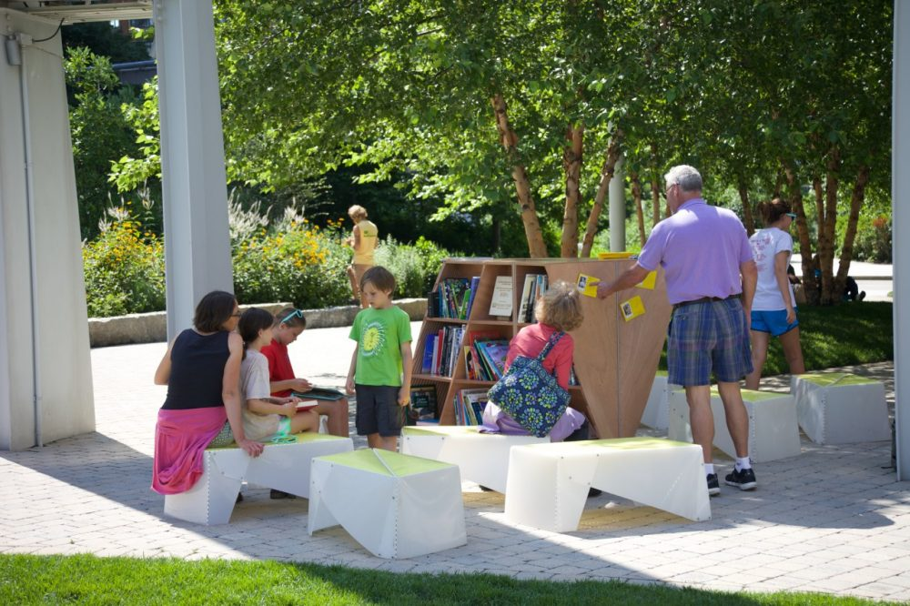 Adults and children explore the pop-up reading room at the Wharf District Park. (Photo courtesy Sam Davol)