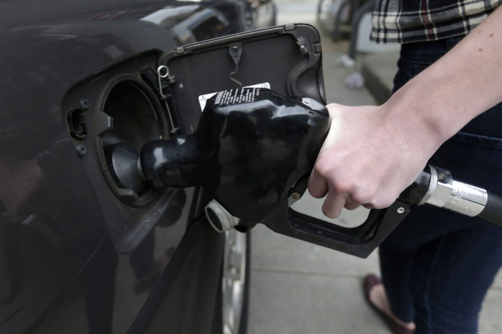 In this Tuesday, April 29, 2014 photo a customer fills her car with fuel at a gas station, in Brookline. (Steven Senne/AP)