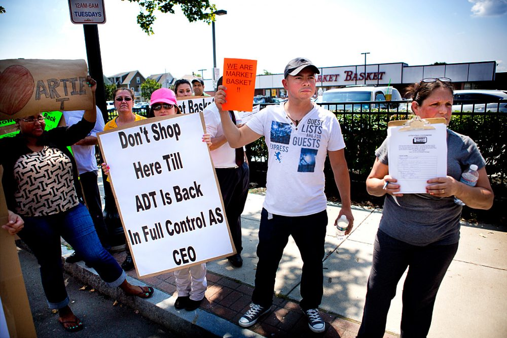 Market Basket employees protested outside of the Somerville store near Union Square Tuesday afternoon. At a rally in Tewksbury Monday, protest organizers urged employees to take their fight to have Arthur T. reinstated back to their own stores. (Jesse Costa/WBUR)
