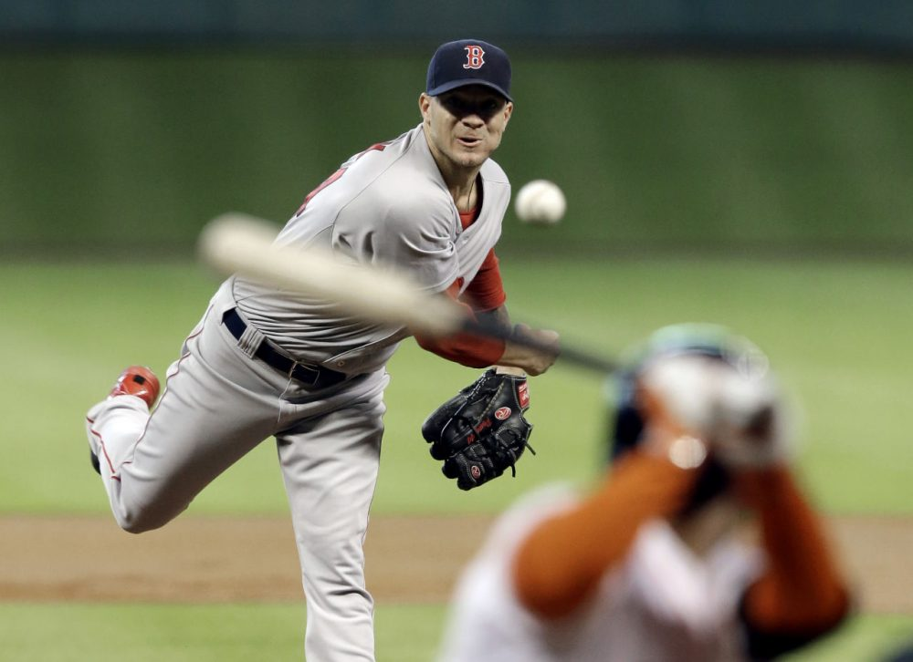 Boston Red Sox's Jake Peavy, left, delivers a pitch to Houston Astros' Jose Altuve in the first inning. (AP/Pat Sullivan)
