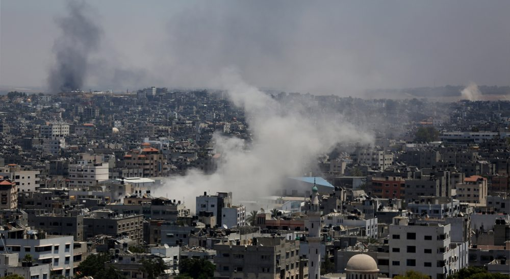 """Jim Walsh: """"A metaphor can be a dangerous thing. It can even kill."""" Pictured: Smoke from an Israeli strike rises over Gaza City, Thursday, July 24, 2014. Israeli tanks and warplanes bombarded the Gaza Strip on Thursday, as Hamas militants stuck to their demand for the lifting of an Israeli and Egyptian blockade in the face of U.S. efforts to reach a cease-fire. (Hatem Moussa/AP)"""