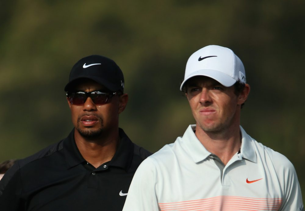Tiger Woods (left) finished 69th at the 2014 British Open, which was won by Rory McIlroy (right). (Warren Little/Getty Images)