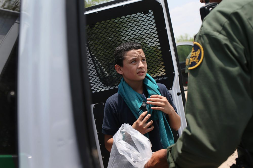 A U.S. Border Patrol agent prepares to take an unaccompanied Salvadorian minor, 13, to a processing center after he crossed the Rio Grande from Mexico into the United States on July 24, 2014 in Mission, Texas. Tens of thousands of unaccompanied minors and immigrant families have crossed illegally into the United States this year and presented themselves to federal agents, causing a humanitarian crisis on the U.S.-Mexico border. (John Moore/Getty Images)