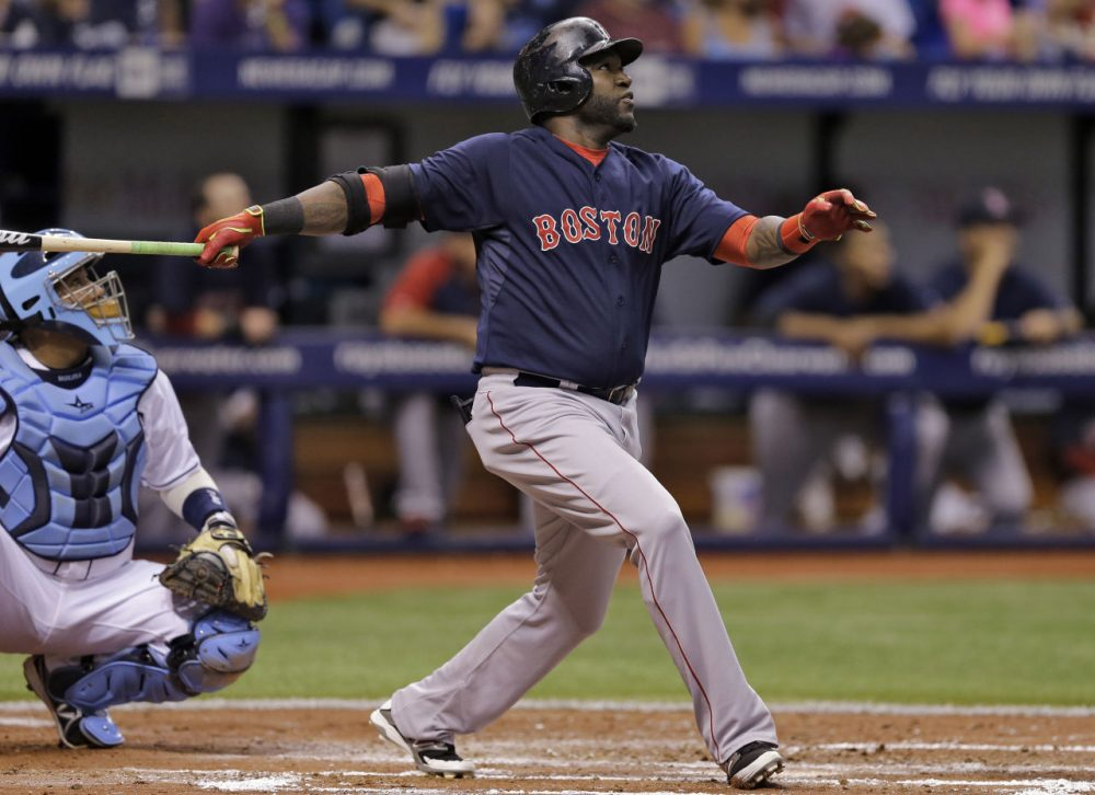 Boston Red Sox's David Ortiz flies out to Tampa Bay Rays center fielder Desmond Jennings during the fourth inning of a baseball game Friday, July 25, 2014, in St. Petersburg, Fla. Catching for the Rays is Jose Molina. (Chris O'Meara/AP)