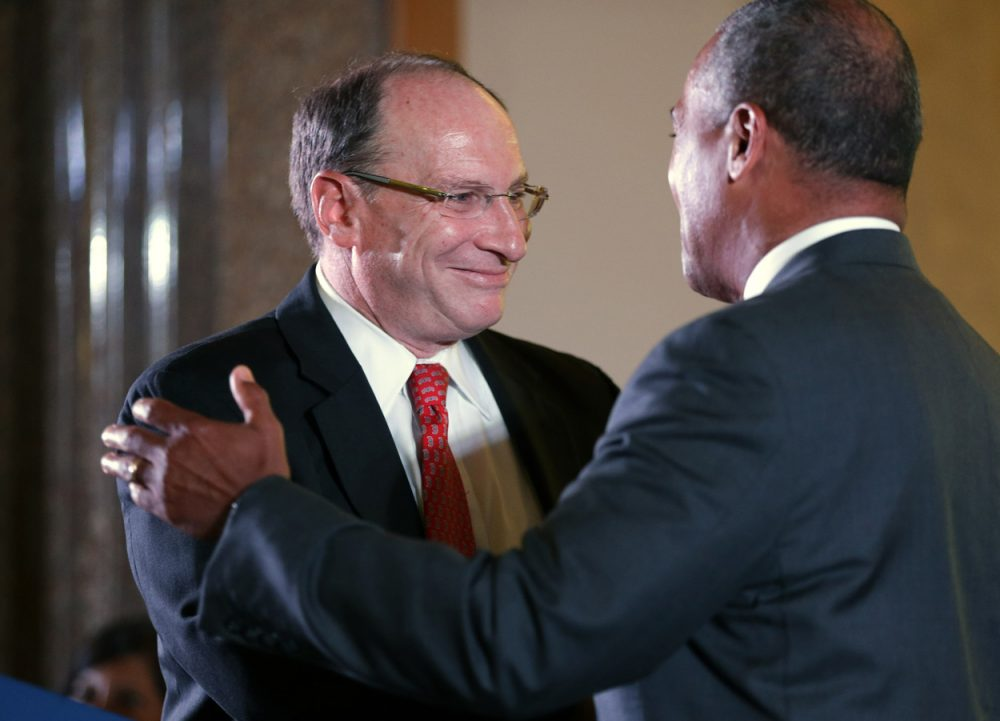 Chief Justice of the Supreme Judicial Court Ralph Gants, left, embraces Mass. Gov. Deval Patrick, right, seconds after being sworn in by Patrick as chief justice during ceremonies at the John Adams Courthouse on Monday. (Steven Senne/AP)