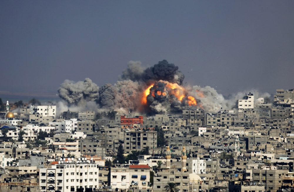 Smoke and fire from the explosion of an Israeli strike rise over Gaza City Tuesday. (Hatem Moussa/AP)