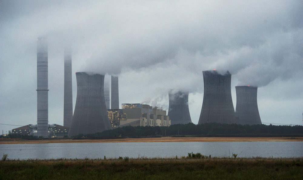The coal-fired Plant Scherer is shown in operation early Sunday, June 1, 2014, in Juliette, Ga. Congress is considering a bill that would create a carbon tax and divide the revenue among the American public. (John Amis/AP)