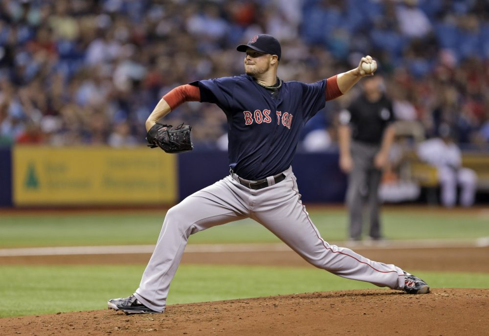 Boston Red Sox starting pitcher Jon Lester delivers to Tampa Bay Rays during the sixth inning of a game Friday, July 25. (Chris O'Meara/AP)