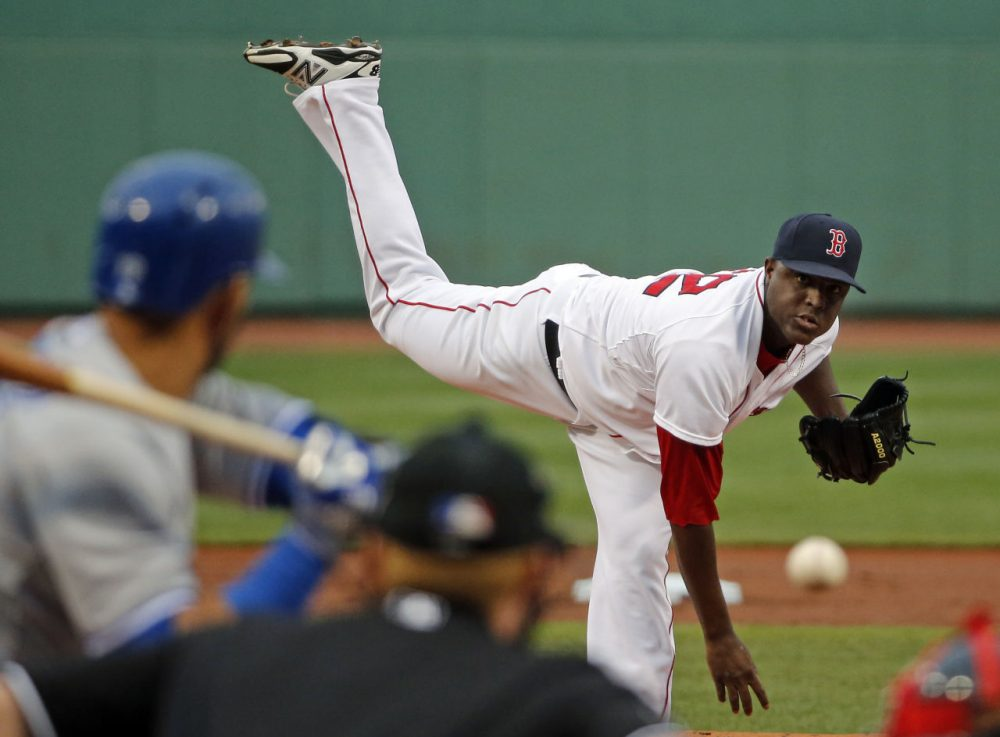 Boston Red Sox starting pitcher Rubby De La Rosa delivers to the Toronto Blue Jays during the first inning of a baseball game at Fenway Park in Boston, Tuesday, July 29, 2014. (Elise Amendola/AP)