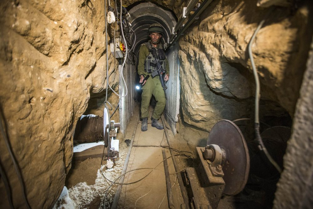 An Israeli army officer gives journalists a tour of a tunnel at the Israel-Gaza Border allegedly used by Palestinian militants for cross-border attacks. (Jack Guez/AP/Pool)