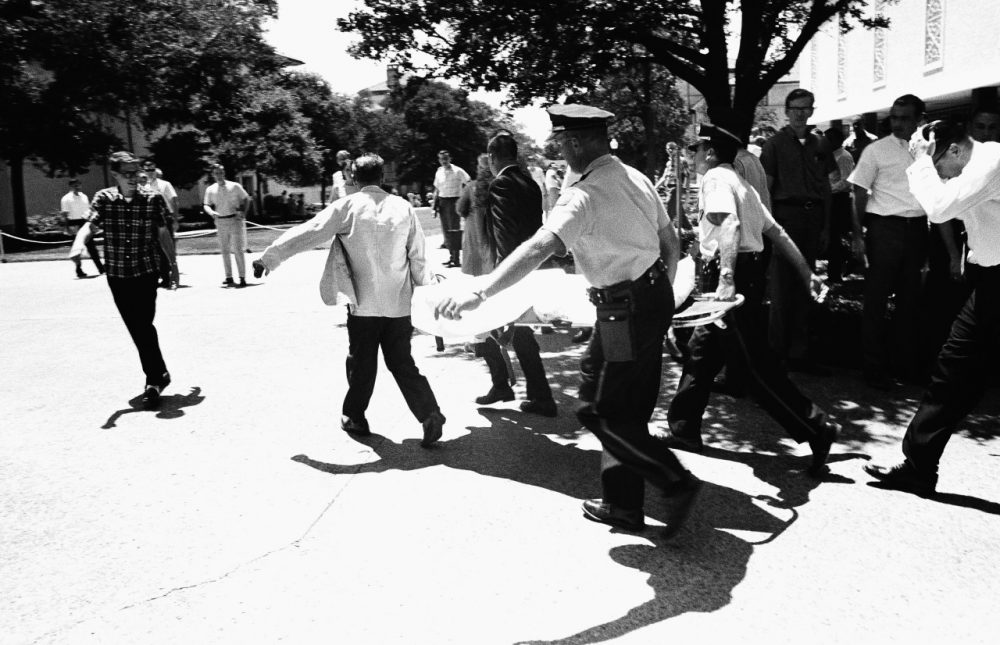 One of the victims of Charles Joseph Whitman, the sniper who gunned down victims from a perch in the University of Texas tower, is carried across the campus to a waiting ambulance, Aug. 1, 1966 in Austin. The unidentified victim was gunned down inside the tower, according to police on the scene. (AP)